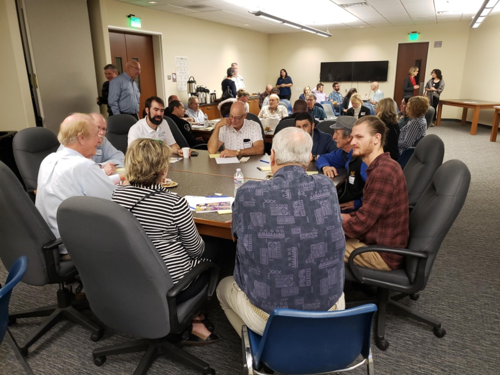 Manufacturers meet in groups to discuss the local economy